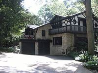 709 Crescent Boulevard two story stone and wood home