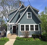 725 Highland Avenue two story blue clapboard home
